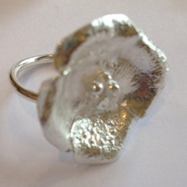 Reticulated sterling silver flower rings…