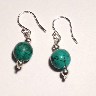 Sterling silver earrings with round malachite and silver beads.