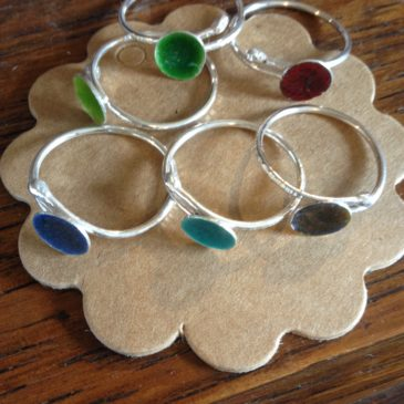 Domed and enamelled rings