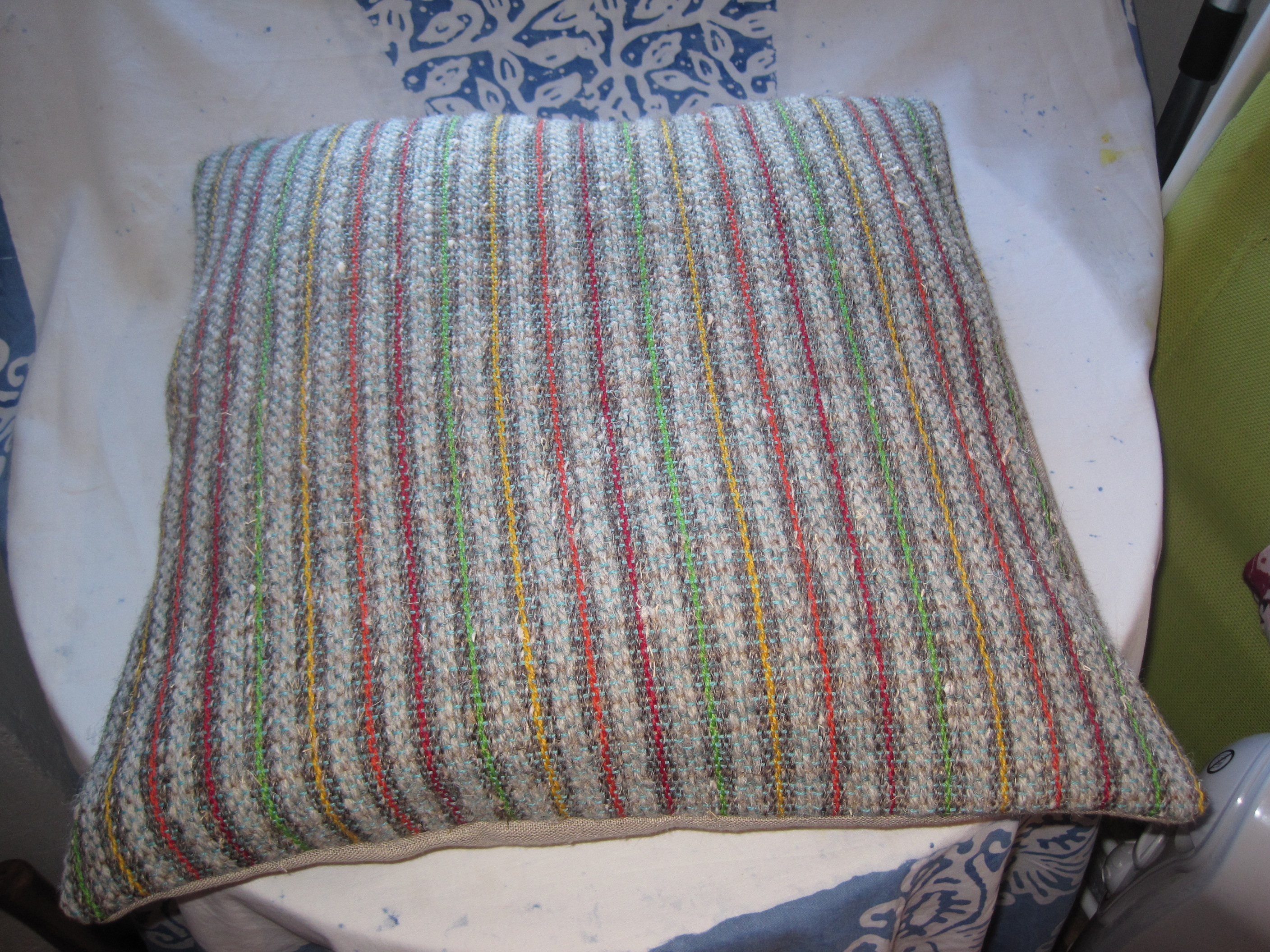 Grey berber wool and raw linen with primary colour highlights. Sold.