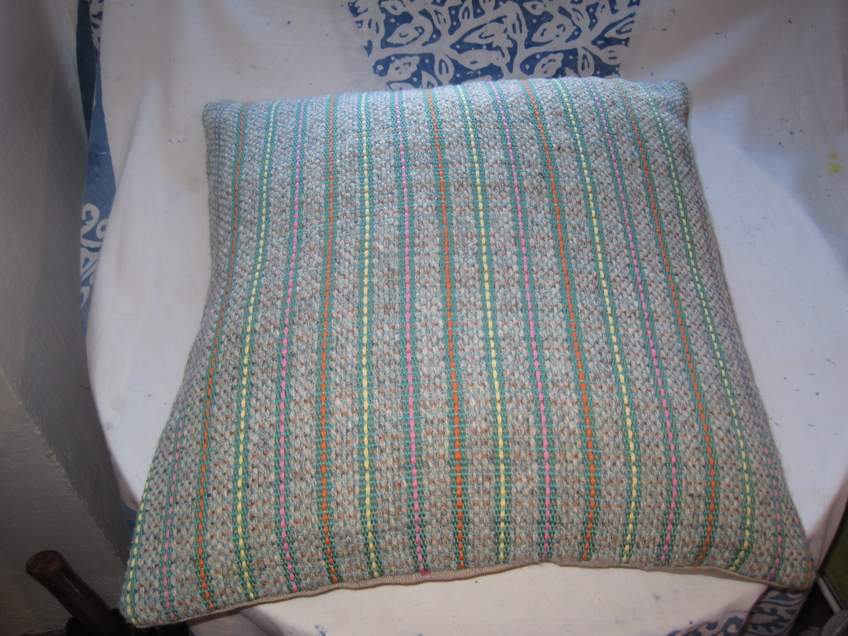 Grey berber wool and leaf green cotton with pink, orange and yellow highlights