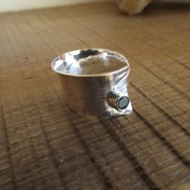 Ring – Sterling silver hammered and formed ring with faceted stone