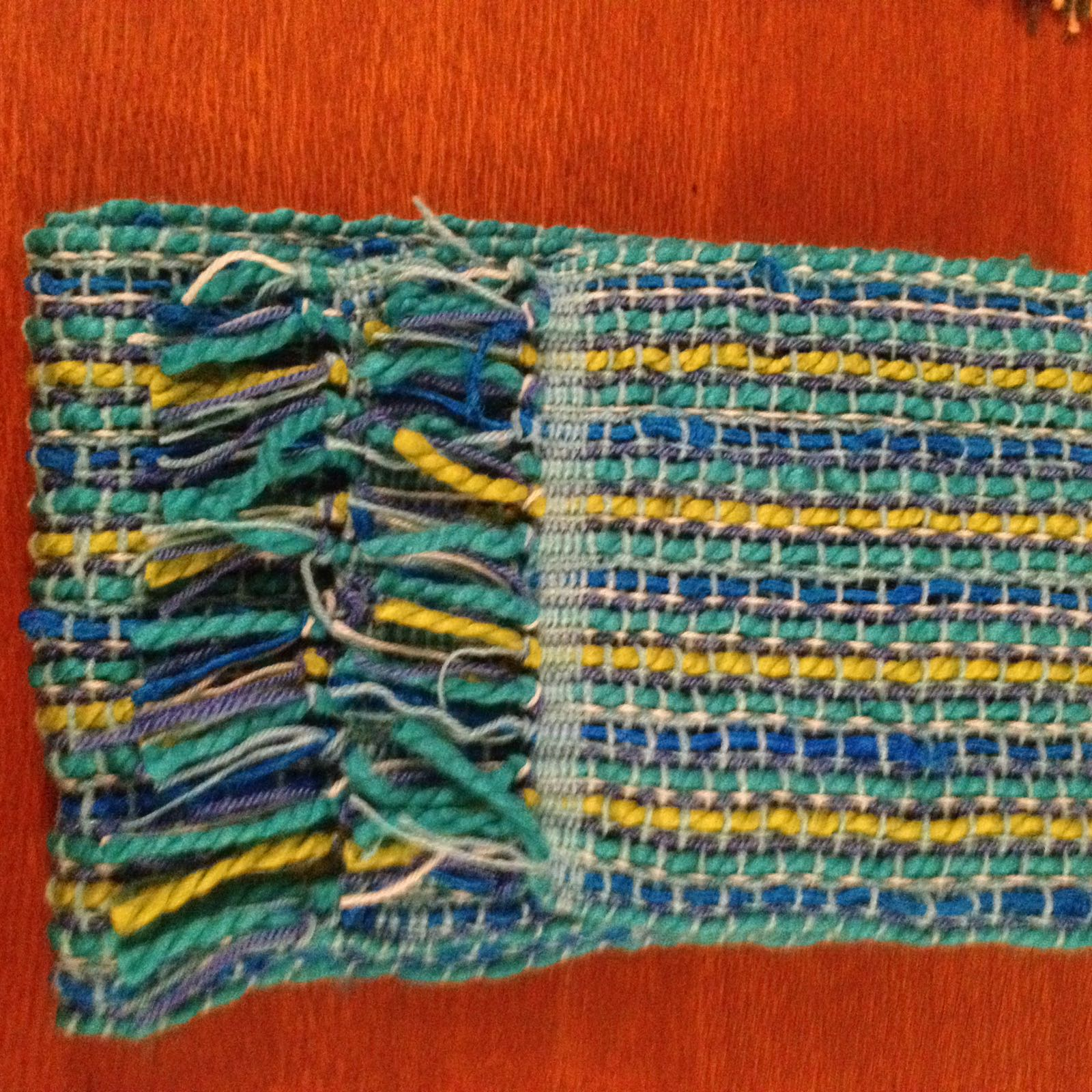 Scarf in turquoise, light green and blues. Acrylic with silk highlights.