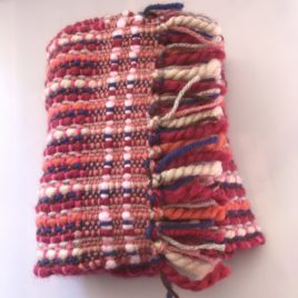 Handwoven Scarf in red, orange, brown, beige and blues.