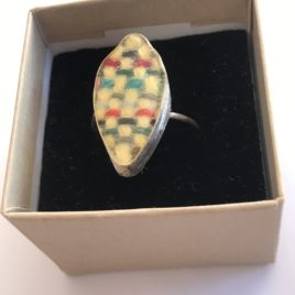 Ring – Sterling silver wire ring with woven textile set in silver bezel