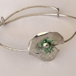 Bracelet – Sterling silver wire bracelet with reticulated flower motif